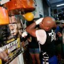 Floyd Mayweather Jr. (L) works out with Nate Jones at the Mayweather Boxing Club on September 2, 2014 in Las Vegas, Nevada