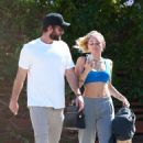 Miley Cyrus in Sports Bra with Liam Hemsworth at The Sun Cafe in Studio City