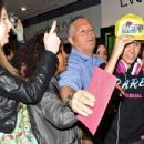 Justin Bieber gets mobbed by eager fans as he lands at Heathrow International Airport