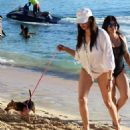 Lauren Silverman in White Bikini – Walking her dog at a beach in Barbados - 454 x 491