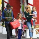Busy Phillips goes holiday shopping with her family at The Grove in Los Angeles, California on December 10, 2016 - 454 x 583