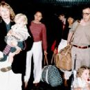 Farrow and her ex-partner Woody Allen with Soon-Yi (in the red), Lark (in the black top), Ronan (in Farrow's arms) and Eliza (in the pushchair) at Heathrow Airport in 1989