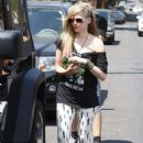 Avril Lavigne shopping at Popkiller Clothing store in Hollywood, CA (August 1)