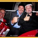 Metin Bereketli and the immortal Dom Deluise sharing a warm moment at the Feast of San Gennaro Los Angeles. - 454 x 320