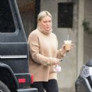Hilary Duff – Grabs a coffee on a rainy day in Los Angeles