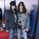 Slash and Meegan Hodges attend Halloween Horror Nights 2018 at Universal Studios Hollywood on September 14, 2018 in Los Angeles, California - 417 x 600