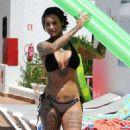 Jemma Lucy in Bikini on the pool in Portugal - 454 x 843