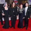 Kelly Osbourne, Ozzy Osbourne, Sharon Osbourne and Jack Osbourne attend the Pride of Britain awards at The Grosvenor House Hotel on September 28, 2015 in London, England. - 454 x 300