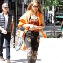 Gigi Hadid – Out in orange while out in New York