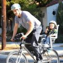 Josh Duhamel is spotted enjoying a bicycle ride with his growing son Axl on January 8, 2016 in Brentwood - 454 x 590