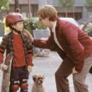 Pistachio (Dana Carvey) helps Barney (Austin Wolff) ride his skateboard