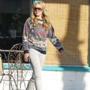 Amanda Bynes steps out looking healthy showing off new lighter hair as she goes shopping with her family