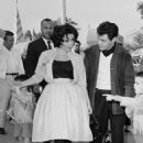 Liz took her two sons by Michael Todd to Disneyland wearing a typically Fifties full skirt. She was joined on the day by singer Eddie Fisher, whom she was dating at the time - 454 x 681