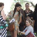 """Jessica Szohr wears a short, multi colored dress and a long necklace with turquoise as she films a scene for the popular TV series """"Gossip Girl"""""""