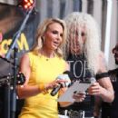 Dee Snider of Twisted Sister on stage with host Elisabeth Hasselbeck during 'FOX & Friends' All American Concert Series outside of FOX Studios on July 25, 2014 in New York City.