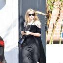 Dakota Fanning in Black Dress at Nine Zero One salon in West Hollywood - 454 x 639