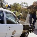 Jay (Emile Hirsch) en route to escape after the cops bust a pool session.