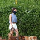 Aubrey Plaza – Wearing shorts and walking her dogs in Los Angeles
