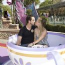 Ryan Sweeting and actress Kaley Cuoco Sweeting take a ride on The Mad Tea Party attraction at Disneyland on February 15, 2014 in Anaheim, California