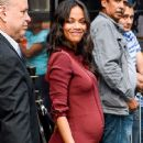 Zoe Saldana Looks Radiant, Shows Baby Bump in Burgundy Shirtdress