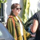 Dakota Johnson with a friend out in the West Hollywood