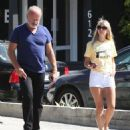 Kelsey Grammer and his wife stop by the Andy LeCompte Salon in West Hollywood, California on September 29, 2015 - 454 x 535