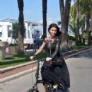 Catrinel Marlon – Riding her bike in Cannes - 454 x 681