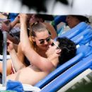Joe Jonas kissing his sexy and sultry girlfriend Blanda Eggenschwiler while soaking the sun by their hotel pool during a trip to Brazil