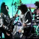 Musicians Gene Simmons, Tommy Thayer and Eric Singer of KISS perform onstage during the 23rd Annual Race To Erase MS Gala at The Beverly Hilton Hotel on April 15, 2016 in Beverly Hills, California.