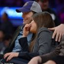 Mila Kunis and boyfriend Ashton Kutcher were all smiles as they puckered up for the Kiss Cam at a Lakers game in L.A. on Friday, Jan. 3