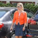 Reese Witherspoon is seen out in bright orange and white glasses on April 1, 2016