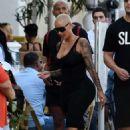 Amber Rose in a black dress on Ocean Drive in Miami Beach