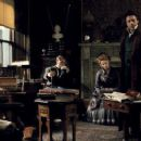 (L-r) JUDE LAW as Dr. John Watson, KELLY REILLY as Mary Morstan and ROBERT DOWNEY JR. as Sherlock Holmes in Warner Bros. Pictures' and Village Roadshow Pictures' action-adventure mystery 'Sherlock Holmes,' distributed by Warner Bros. Pictu