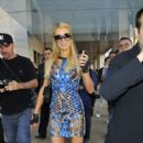 Paris Hilton leaves a fashion show