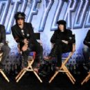 (L-R) Musicians Vince Neil, Nikki Sixx, Mick Mars and Tommy Lee speak onstage to announce their upcoming Motley Crue and KISS co-headlining tour at the Hollywood Roosevelt Hotel on March 20, 2012 in Los Angeles, California