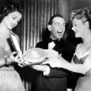 Margaret Lockwood and Glynis Johns admire the BAFTA award won by Norman Wisdom as the Most Promising Newcomer to Film, 1954