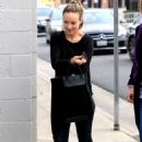 Olivia Wilde – Leaving a business lunch in Los Angeles