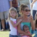 Denise Richards takes her baby daughter Eloise to the park with older daughters Lola and Sam to watch Sam's soccer game