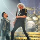 Adam Lambert performs with Brian May and Roger Taylor of Queen at 02 Arena on January 17, 2015 in London, England.