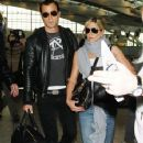 """""""Horrible Bosses"""" star Jennifer Aniston and new beau Justin Theroux are seen arriving at Heathrow Airport together in London. The new couple are seen walking hand in hand as they wear sunglasses while they receive attention"""