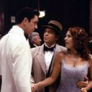 Matthew Broderick and Joely Fisher meet up with the rich and debonair Sanford Scolex (Rupert Everett)... who is secretly the devilish Claw in Disney's Inspector Gadget - 1999 - 350 x 232