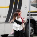 Suri and Kate surprise daddy!