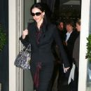L'Wren Scott and Mick Jagger Leaving La Petite Maison Restaurant on December 3, 2008