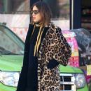 Alexa Chung stops for coffee while out and about in New York City, New York on March 23, 2017