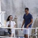 Lily Collins in a bikini on the beach in Ischia