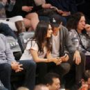 Mila Kunis: at the LA Lakers game at the Staples Center