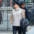 Pamela Anderson visits an art gallery with her boyfriend Rick Salomon on November 13, 2013 in New York City, New York