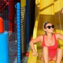 Billie Faiers in Red Swimsuit at a water park in Dubai - 454 x 551