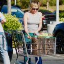 Miley Cyrus and Cody Simpson – Shopping candids in Los Angeles