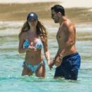 Lauren Pope in Blue Bikini on the beach in Barbados - 454 x 351